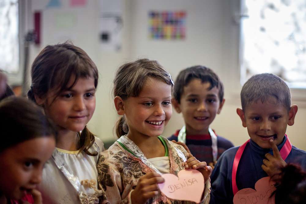 """Denisa (3rd left) and other children attend the kindergarten in the community center situated in the Roma settlement """"Budulovska Street"""" in Moldava nad Bodvou. The community center was in this time (2014) a metal, prefabricated building, which not only houses the local Roma school, but also serves as a performance space and local hangout for older Roma kids and teenagers. From about 800 inhabitants of the segregated settlement 'Budulovska Street' (2014) are roughly 392 children up to the age of 16 years."""
