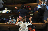 Parishioners pray during during Easter Sunday services at Fuente de Vida Church in east Salinas.