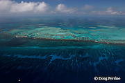 aerial view of Gladden Spit, a finger of the Belize Barrier Reef where currents attract fish spawning aggregations, showing reef top, reef crest, and spur and groove coral formations; note boat over drop-off in lower left;  near Placencia, Stann Creek District, Southern Belize, Central America ( Caribbean ),  Gladden Spit and Silk Cayes Marine Reserve