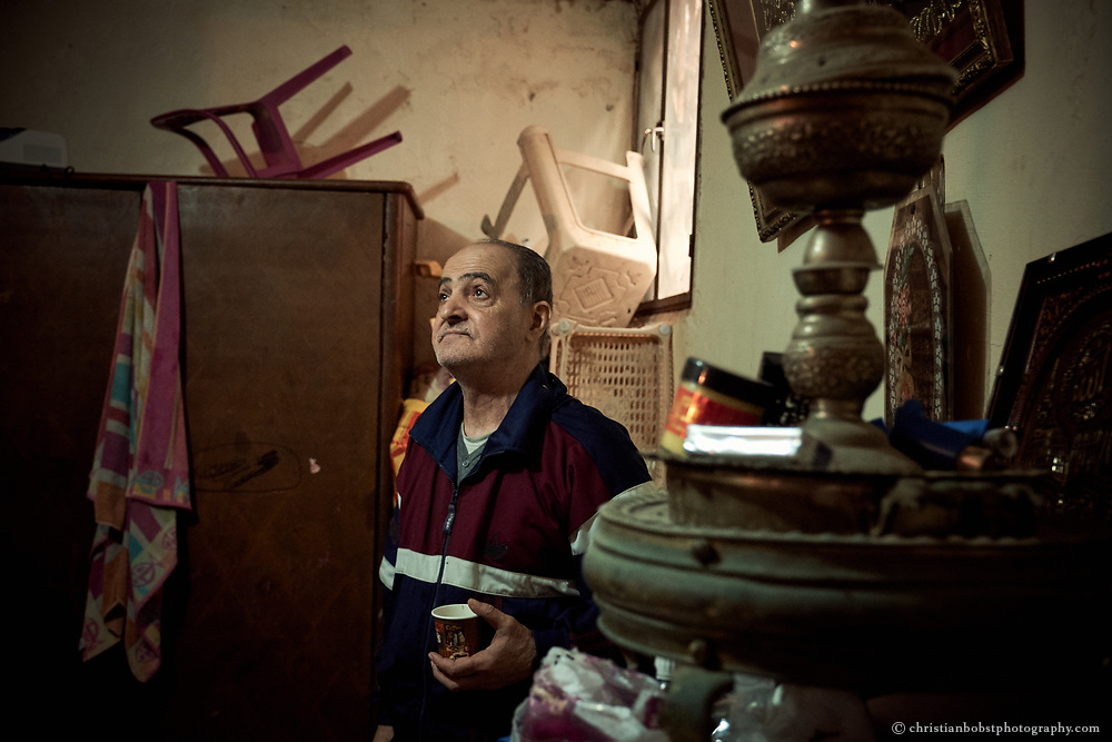 Shatila, Lebanon, April 2017: This Palestinian refugee, who has fled from Syria with his daughter and their children to Shatila, also eagerly hopes to leave the narrow and humid apartment and the camp soon.
