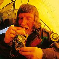 Victor Boyarsky snacks on cheese in his tent at the South Pole, about halfway through the 1989-1990 Trans-Antarctica Expedition.