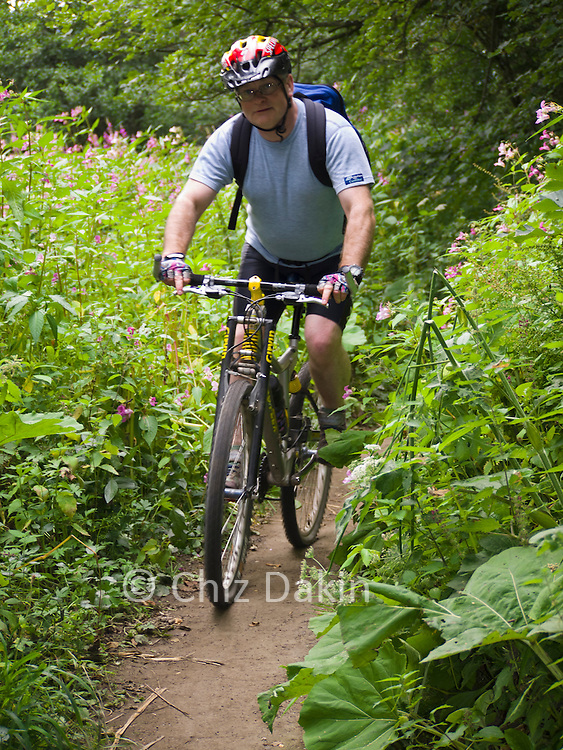 Andy Hayes cycling along the lovely permissive path alongside the River Derwent near Rowsley