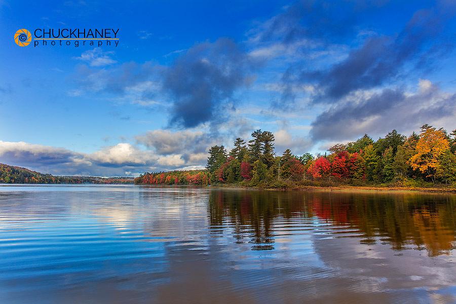 Autumn color relfects in Deer Lake near Munising, Michigan, USA