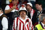 an England fan looking dejected after the final whistle after being knocked out of the Rugby World Cup 2015. Rugby World Cup 2015 pool A match, England v Australia at Twickenham Stadium in London, England  on Saturday 3rd October 2015.<br /> pic by  John Patrick Fletcher, Andrew Orchard sports photography.