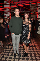 LAURA JACKSON and JON CORRIGAN at the Tunnel of Love art and fashion auction and dinner in aid of the British Heart Foundation held at One Mayfair, London on 12th November 2013.