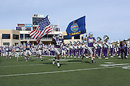 Kansas State's Yamon Figurs (16) and Ian Campbell (98) lead the Wildcats out onto the field before their game against Iowa State at Bill Snyder Family Stadium in Manhattan, Kansas, October 28, 2006.  The Wildcats beat the Cyclones 31-10.<br />