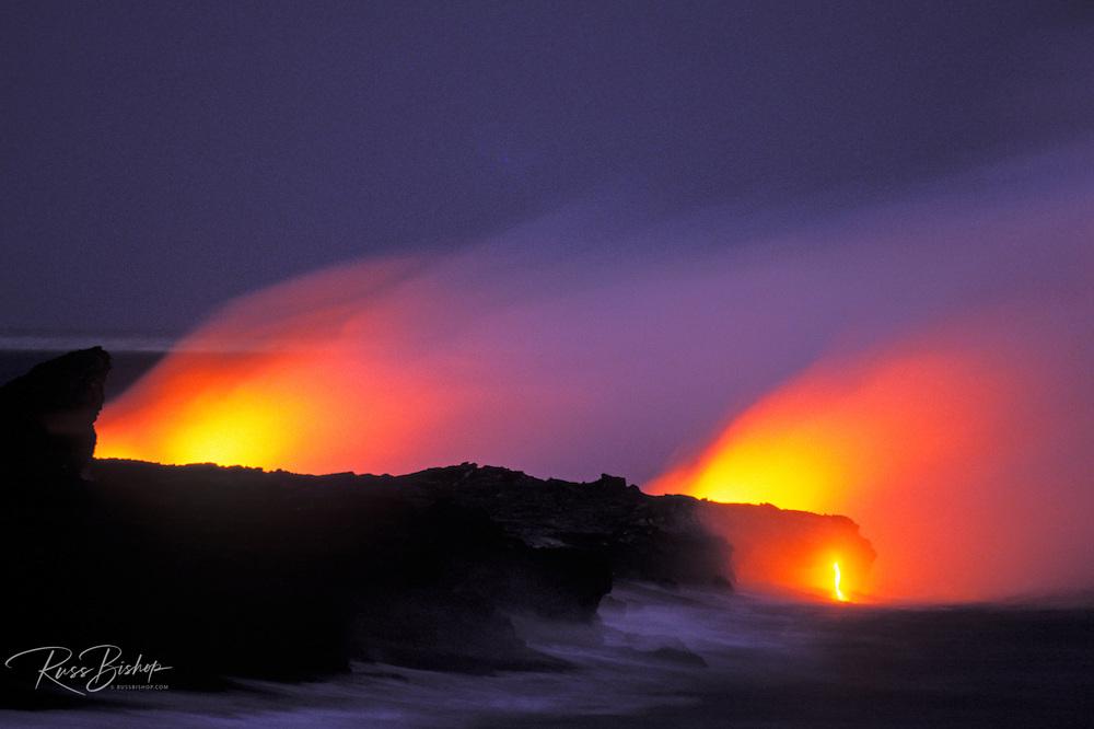 Lava flow entering the Pacific Ocean at dusk, Hawaii Volcanoes National Park, The Big Island, Hawaii
