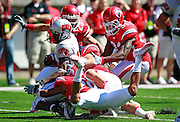UNLV receiver Marcus Sullivan (18) is stopped by several Utah defenders during the first quarter of an NCAA college football game at Rice-Eccles Stadium, Saturday, Sept. 11, 2010, in Salt Lake City, Utah.  Utah defeated UNLV 38-10(AP Photo/Colin E. Braley)