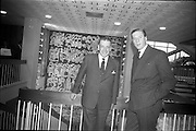 """01/06/1964<br /> 06/01/1964<br /> 01 June 1964<br /> Opening of new Marketing Headquarters of P.J. Carroll and Company Ltd. at Grand Parade on the Grand Canal, Dublin. The premises were officially opened by Taoiseach Sean Lemass. Picture shows Sean Lemass unveiling the tapestry, """"Brendan the Navigator"""" in the new building. Mr. Don Carroll, Chairman of P.J. Carroll and Co. Ltd. is also in the picture on right."""