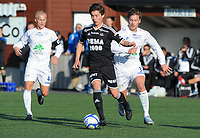 Fotball NM Cup 1.runde Orkla-Rosenborg<br /> 24 april 2014<br /> <br /> Orkdalsbanken Stadion, Fannrem<br /> <br /> <br /> Rosenborgs yngste debutant noensinne, John Hou Sæter med ballen. Bak ham: Morten Pedersen, Orkla. Til venstre : 4 Steinar Opøyen Gjersvold, Orkla<br /> <br /> <br /> <br /> Foto : Arve Johnsen, Digitalsport
