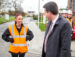 Pictured: Jamie Hepburn met Laura Doherty, Trainee Assistant Site Manager (Roberston's 100th apprentice)<br /> Minister for Employability and Training Jamie Hepburn  responded to the latest Labour market statistics when he visited Robertson Partnership Homes in Edinburgh today and met some of their construction workers<br /> <br /> <br /> Ger Harley | EEm 15 November 2017