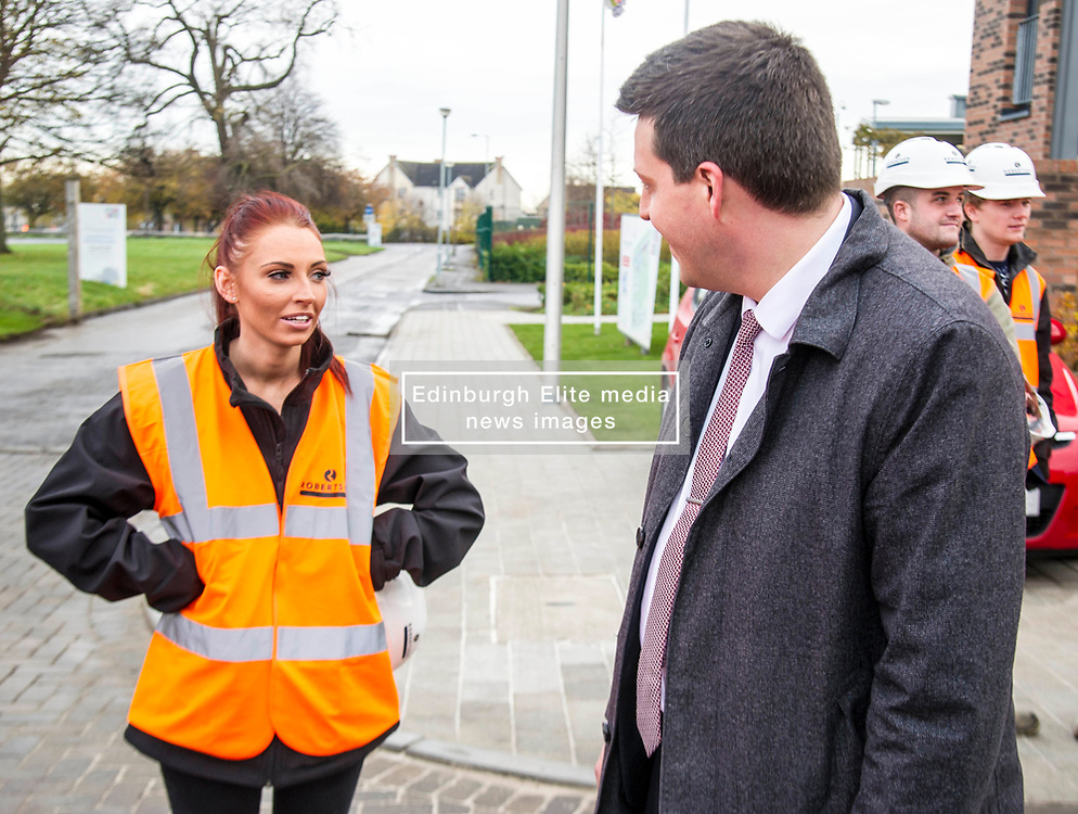 Pictured: Jamie Hepburn met Laura Doherty, Trainee Assistant Site Manager (Roberston's 100th apprentice)<br /> Minister for Employability and Training Jamie Hepburn  responded to the latest Labour market statistics when he visited Robertson Partnership Homes in Edinburgh today and met some of their construction workers<br /> <br /> <br /> Ger Harley   EEm 15 November 2017