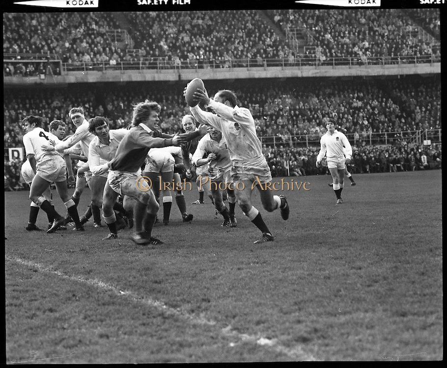 Ireland Vs England at Lansdowne Rd..1971..13.02.1971..02.13.1971..13th February 1971..In the Five Nations Championship, Ireland took on England at Lansdowne Road,Dublin. The final score in the game was Ireland 6,England 9..Bob Hiller,the England fullback,scored all his teams points with three penalties..Ireland replied with two tries from Grant and Duggan..In the championship,Wales won the Triple Crown and completed the Grand Slam when they defeated France in their final game of the season..Pictured is some of the action on the pitch,here an England attacker tries to bypass Fergus Slattery in an attempt to gain ground.