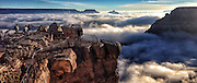 Dec 3, 2013 - Grand Canyon, Arizona, U.S. - <br /> <br /> Rare Fog Engulfs Grand Canyon<br /> <br /> In a photo released by the National Park Service, tourists look out over a rare total cloud inversion at Grand Canyon National Park Friday. Cloud inversions are created through the interaction of warm and cold air masses.<br /> ©Erin Whittaker/Exclusivepix
