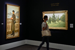 "© Licensed to London News Pictures. 02/06/2017. London, UK. A visitor walks by (L to R) ""Portrait of Yuri Repin by the Bay of Naples"", 1894, by Ilya Repin (Est. GBP 0.7-1m) and ""Summer"", 1891, by Isaak Levitan (est. 1-1.5m).  Preview of Sotheby's sale of Russian pictures and works of art which takes place on 6 June 2017 at Sotheby's in New Bond Street. Photo credit : Stephen Chung/LNP"