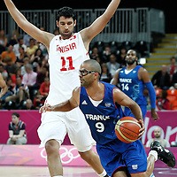 04 August 2012: France Tony Parker drives past Tunisia Mokhtar Ghayaza during 73-69 Team France victory over Team Tunisia, during the men's basketball preliminary, at the Basketball Arena, in London, Great Britain.