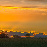 The sun sets over pastures in Montana's Gallatin Valley near Bozeman and  Belgrade.
