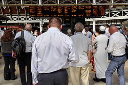 © Licensed to London News Pictures. 19/07/2016. London, UK. Commuters wait for notification of their next train home as high track temperatures cause delays due to trains running at reduced speed between Paddington and Reading, or trains being cancelled all together. Photo credit : Stephen Chung/LNP