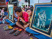 29 SEPTEMBER 2016 - BANGKOK, THAILAND: Residents of Pom Mahakan hold up pictures of the King and Queen of Thailand while they blockade the south entrance to the old fort. Forty-four families still live in the Pom Mahakan Fort community. The status of the remaining families is not clear. Bangkok officials are still trying to move them out of the fort and community leaders are barricading themselves in the fort. The residents of the historic fort are joined almost every day by community activists from around Bangkok who support their efforts to stay.     PHOTO BY JACK KURTZ