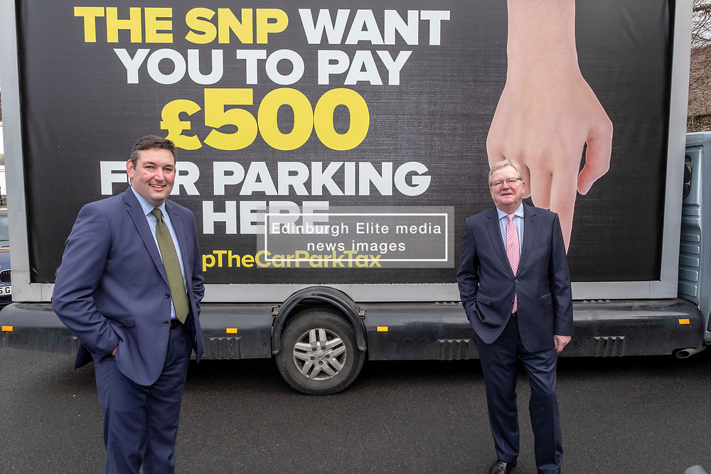 Pictured: <br />Today the Scottish Conservatives launched an advertising campaign against the Car Park Tax, with the SNP and the Greens set to vote it through Holyrood. Jackson Carlaw MSP and Miles Briggs MSP unveiled an Ad Van at Letham Park Care Home Edinburgh before it travels across the central belt to workplaces that are set to be hit by the parking charge.<br /><br />Ger Harley   EEm 21 February 2019