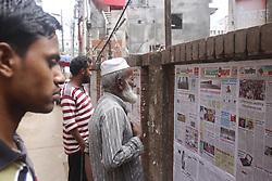 May 26, 2019 - Dhaka, bangladesh - People read newspaper on a street wall in Dhaka. (Credit Image: © MD Mehedi Hasan/ZUMA Wire)