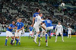Wayne Rooney of England heads the ball as Marco Parolo of Italy challenges - Photo mandatory by-line: Rogan Thomson/JMP - 07966 386802 - 31/03/2015 - SPORT - FOOTBALL - Turin, Italy - Juventus Stadium - Italy v England - FIFA International Friendly Match.