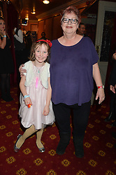JO BRAND and IMOGEN SAVILL niece of Hello! editor Rosie Nixon at a VIP evening for the pantomime Aladdin at The New Wimbledon Theatre, The Broadway, Wimbledon, London SW19 on 9th December 2013.