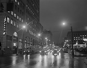 Y-550204-0.  Night view of SW 6th & Taylor looking south. February 4, 1955.