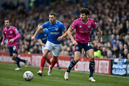 Queens Park Rangers Midfielder, Pawel Wszolek (23) and Portsmouth Defender, Lee Brown (3) during the The FA Cup fourth round match between Portsmouth and Queens Park Rangers at Fratton Park, Portsmouth, England on 26 January 2019.