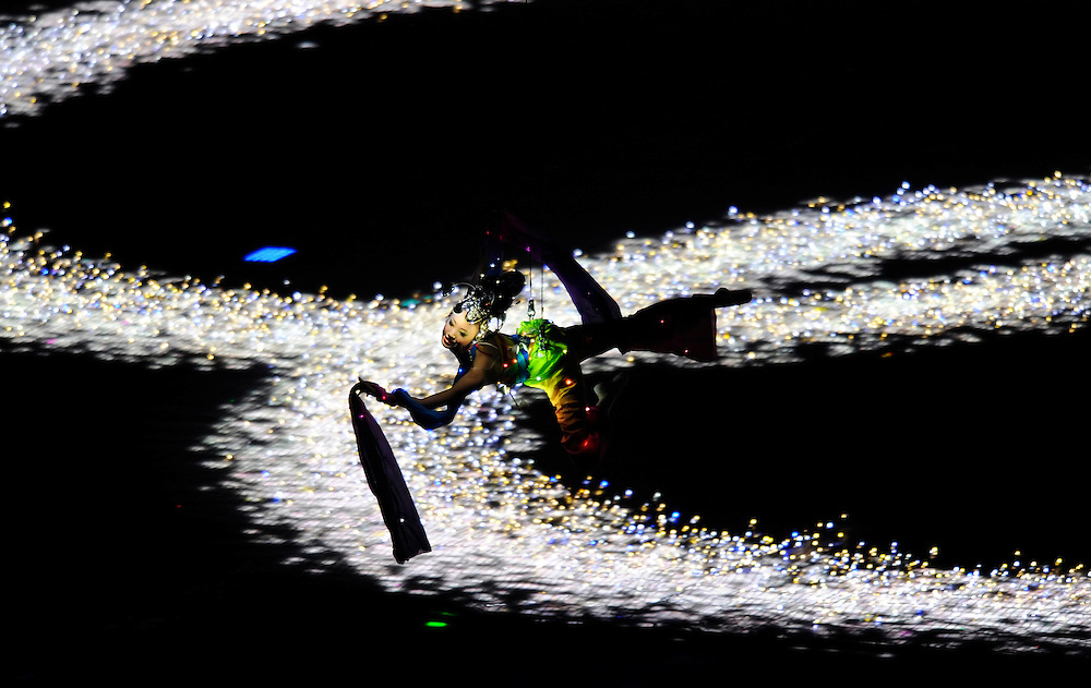 An acrobat on an aerial harness flew through the air inside the Beijing Olympic Stadium during the Opening Ceremonies of the 2008 Summer Olympic Games in Beijing, China. (photo by David Eulitt / MCT)
