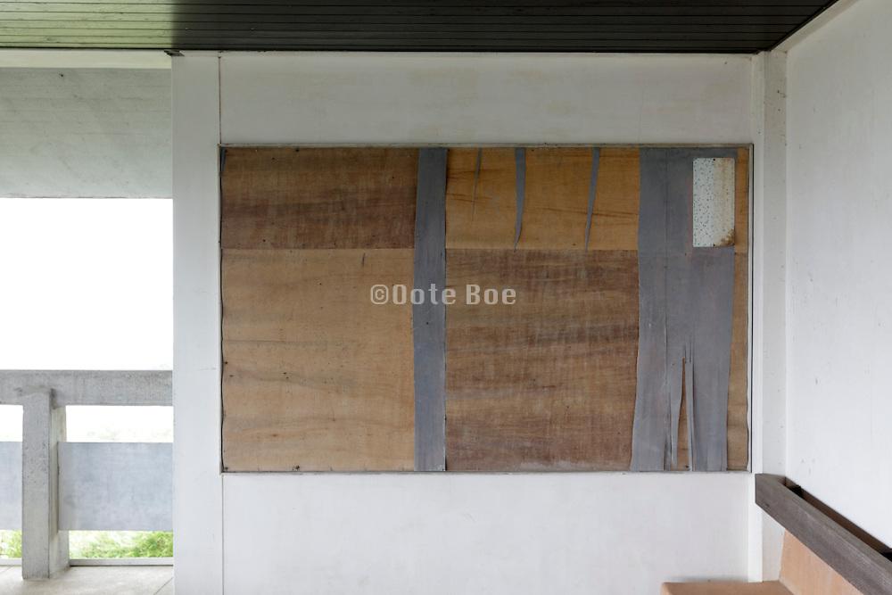 large empty bulletin board on a wall