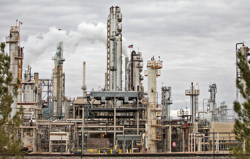 American flags on top of the Navajo Refinery in Artesia, New Mexico, an industrial site recently identified as a top U.S. emitter of a cancer-causing air pollutant.