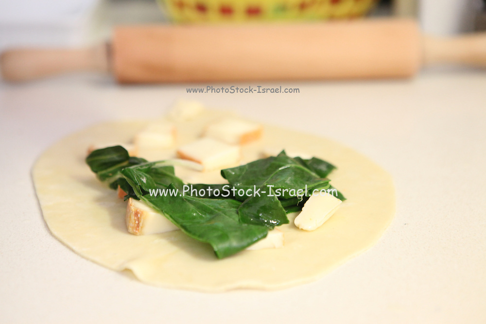 home made Cheese Focaccia adding the filling of Cheese and Chard leaves