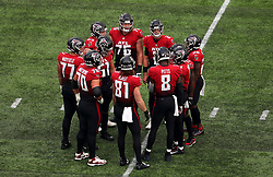 Atlanta Falcons players have a team huddle as they call a time out during the match which is part of the NFL London Games at Tottenham Hotspur Stadium, London. Picture date: Sunday October 10, 2021.
