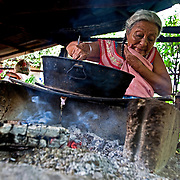The Soconusco farmers roast cocoa beans on clay griddles for family consumption. Mexico.