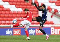 Barnsley's Callum Styles clears under pressure from Middlesbrough's Djed Spence<br /> <br /> Photographer Rich Linley/CameraSport<br /> <br /> The EFL Sky Bet Championship - Barnsley v Middlesbrough - Saturday 10th April 2021 - Oakwell - Barnsley<br /> <br /> World Copyright © 2021 CameraSport. All rights reserved. 43 Linden Ave. Countesthorpe. Leicester. England. LE8 5PG - Tel: +44 (0) 116 277 4147 - admin@camerasport.com - www.camerasport.com