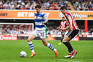 Queens Park Rangers Midfielder Pawel Wszolek (22) and Brentford Defender John Egan (14) in action during the EFL Sky Bet Championship match between Brentford and Queens Park Rangers at Griffin Park, London, England on 21 April 2018. Picture by Stephen Wright.
