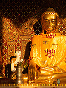 Buddha in one of the stupas in the Shwedagon Pagoda complex in the center of Yangon (Rangoon), It is the most sacred Buddhist stupa in Myanmar and one of the most important religious reliquary monuments in the world