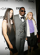 """l to r: Ruskta Bergman, Sean 'Diddy' Combs and Franca Sozanni at the cocktail party celebrating Sean """"Diddy"""" Combs appearance on the """" Black on Black """" cover of L'Uomo Vogue's October Music Issue"""