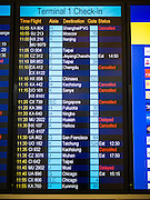 14 AUGUST 2013 - HONG KONG: A flight status board showing cancelled flights in Hong Kong International Airport. Dozens of flights were delayed at one of the busiest airports in Asia and Hong Kong raised their alert to level 8, the highest, and closed schools and many businesses because of Severe Typhoon Utor. The storm passed within 260 kilometers of Hong Kong before making landfall in mainland China. Severe Typhoon Utor (known in the Philippines as Typhoon Labuyo) is an active tropical cyclone located over the South China Sea. The eleventh named storm and second typhoon of the 2013 typhoon season, Utor formed from a tropical depression on August 8. The depression was upgraded to Tropical Storm Utor the following day, and to typhoon intensity just a few hours afterwards. The Philippines, which bore the brunt of the storm, reported 1 dead in a mudslide and 23 fishermen missing at sea.   PHOTO BY JACK KURTZ