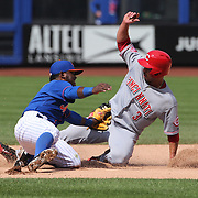 Ivan De Jesus Jr. Cincinnati Reds, is caught stealing second by Dilson Herrera, New York Mets in the Mets 2-1 win in 13 innings during the New York Mets Vs Cincinnati Reds MLB regular season baseball game at Citi Field, Queens, New York. USA. 28th June 2015. Photo Tim Clayton