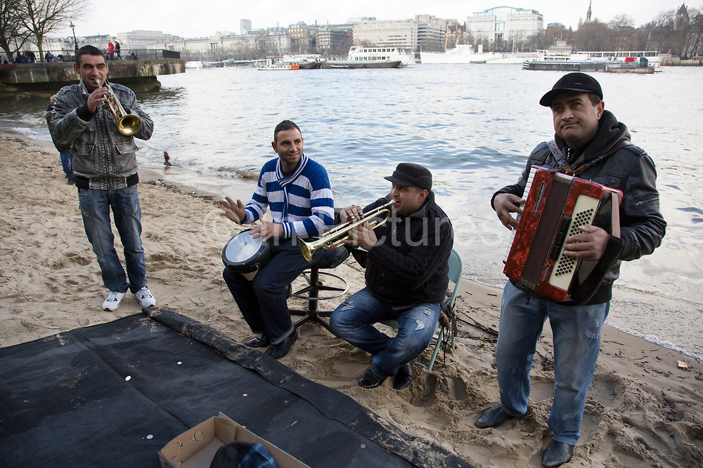 Romanian busking band play their traditional music on the South Bank beach. The South Bank is a significant arts and entertainment district, and home to an endless list of activities for Londoners, visitors and tourists alike.