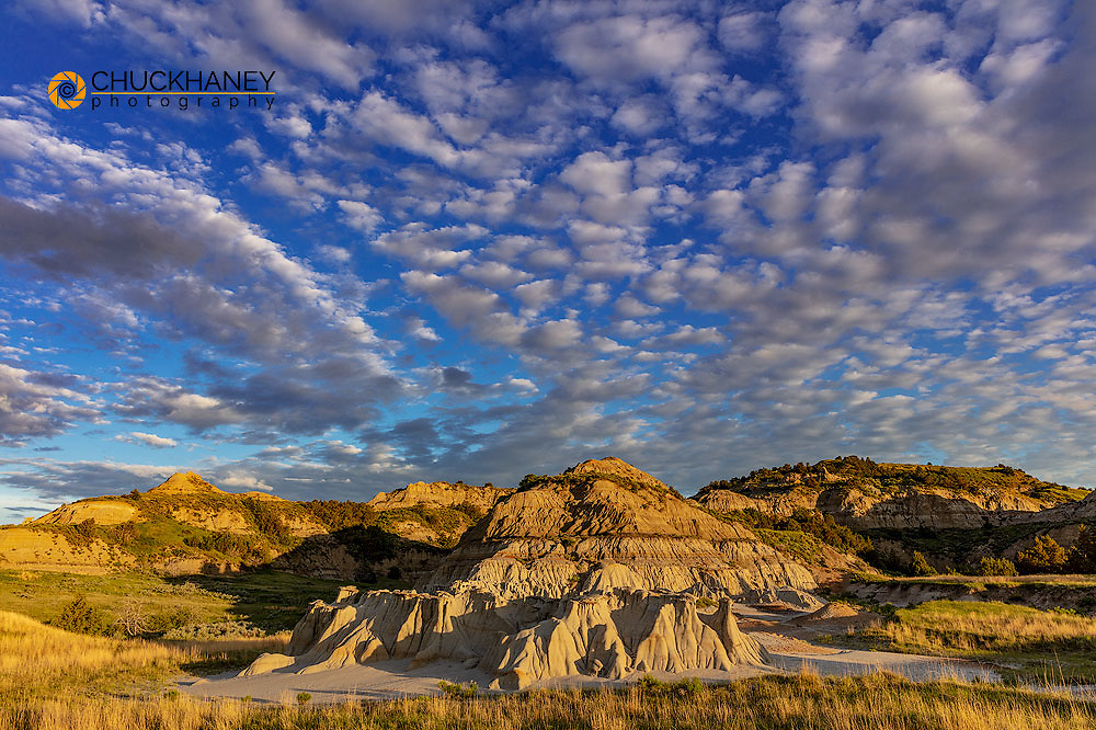 Dramatic sunrise clouds over badlands formations in Theodore Roosevelt National Park, North Dakota, USA
