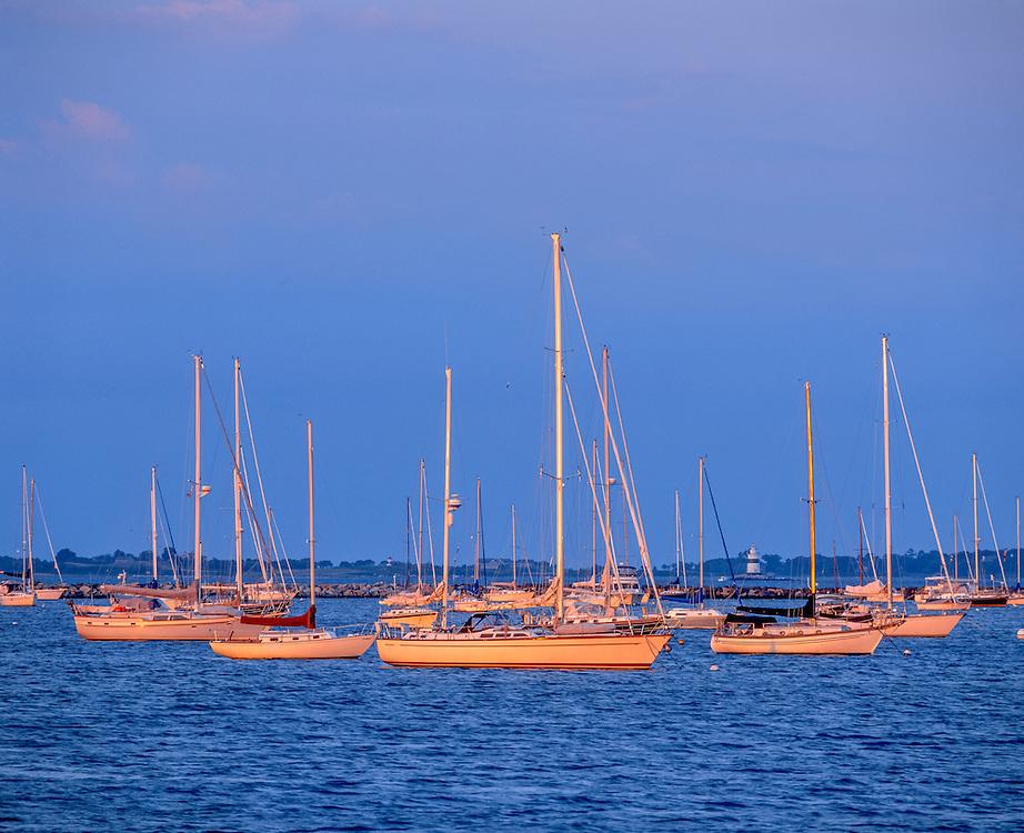 Sailboats moored, first light, Stonington Harbor, distant lighthouse, Stonington, CT