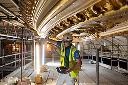 IMAGES SHOT ON APRIL 20TH 2021 © Licensed to London News Pictures. 12/05/2021. Blackpool, UK. Fibrous plasterer Lucas Withey works on the major conservation project taking place in the Tower Ballroom, in Blackpool, Lancashire on April 20, 2021. The Blackpool Tower Ballroom, located in the Grade 1 Listed Tower and which dates back to 1894, has undergone the most extensive programme of work and deep clean for more than 60 years totaling £1.1M. A team of skilled, specialist craftsmen, who have worked across the world on projects including the Queen's Gallery at Buckingham Palace, have dedicated more than 21,000 hours, over a period of six months, to restore the famous Ballroom to its original glory. Due to the Coronavirus pandemic the ballroom has now been closed for over 12 months and is scheduled to re-open to the public on June 21, 2021. Photo credit: Oli Scarff/LNP