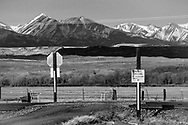 Small rail crossings dot the landscape with gravel roads leading to ranches.