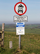 Road signs and car thieves warning sign,  Ridgeway at Hackpen Hill, Wiltshire, England, UK
