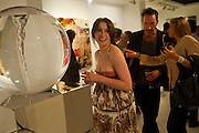 ANNA ABRAMOVICH; PETROC SESTI,NEXT TO PETROC SESTI'S WORK.  Private view and Summer party for Scream Now. An exhibitio of new work by gallery artists. Bruce French,, Derrick Santini, Greg Miller, Malgosia Stepnik, Pakpoom Silaphan, Petroc Sesti, Russell Young. Scream. Bruton st. London. 4 August 2011. <br /> <br />  , -DO NOT ARCHIVE-© Copyright Photograph by Dafydd Jones. 248 Clapham Rd. London SW9 0PZ. Tel 0207 820 0771. www.dafjones.com.