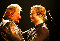 File photo : David Hallyday and his father Johnny Hallyday on stage at the Cigale in Paris on March 17, 2008. France's biggest rock star Johnny Hallyday has died from lung cancer, his wife says. He was 74. The singer - real name Jean-Philippe Smet - sold about 100 million records and starred in a number of films. Photo by Marco Vitchi/ABACAPRESS.COM