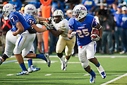 Dec 1, 2012; Tulsa, Ok, USA; Tulsa Hurricanes tailback Ja'Terain Douglas (25) carries the ball during a game against the University of Central Florida Knights at Skelly Field at H.A. Chapman Stadium. Tulsa defeated UCF 33-27 in overtime to win the CUSA Championship. Mandatory Credit: Beth Hall-USA TODAY Sports